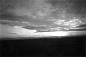 Sunset, Libya, World War II New Zealand troops silhouetted in the distance