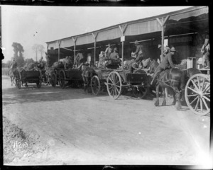 Soldiers on horse drawn carts line up at the NZASC ration dump, Steenbecque, France