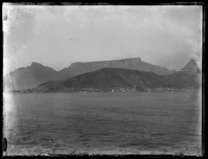 Table Mountain, Lion's Head and Cape Town suburbs Bantry Bay, Clifton, and Camps Bay seen from on board offshore troopship