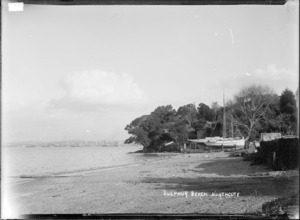 View of yacht on cradle in front of Bailey & Lowe's boatshed, Sulphur Beach, Northcote