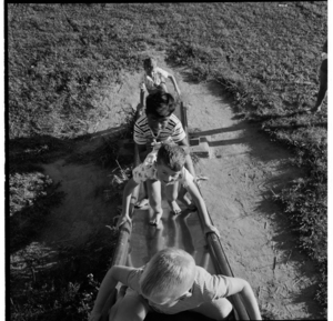 Maori and Pakeha children playing on a slide and see-saw