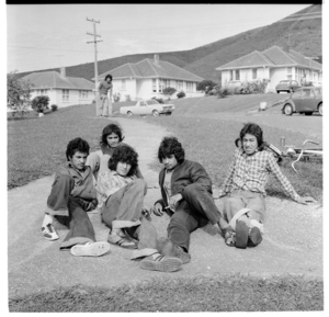 Group of young Māori lounging along a path, possibly in the Delaney Drive area of Stokes Valley