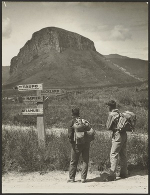 Two men standing by signpost, Atiamuri