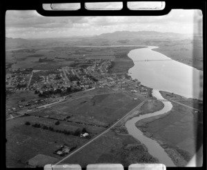 The town of Dargaville with rail station and State Highway 12 Bridge over the Wairoa River, farmland beyond, Northland