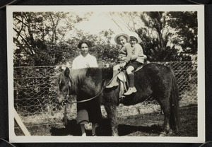 Agnes Isobel Pearce with two children on a pony