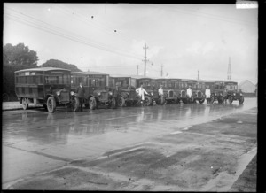Row of Passenger Transport Company buses and drivers, Otahuhu