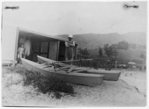 Surf lifesaving club catamaran outside shed, Waihi Beach