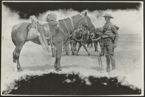 Soldier with troop horse saddled up for a march