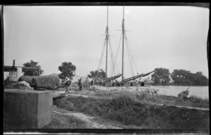 Dredge equipment off-loaded by the scow Vixen, on the banks of the Rangitaiki River