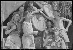 New Zealanders grouped about a cask of wine at the 24 Battalion swimming sports in Arce, Italy - Photograph taken by George Frederick Kaye