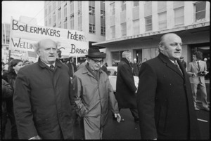 Trade unionists Jim Knox, Leonard Hadley, and Frank Thorn, marching, during a demonstration in Wellington