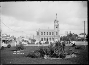 View of the post office at Feilding, looking across gardens in the centre of The Square
