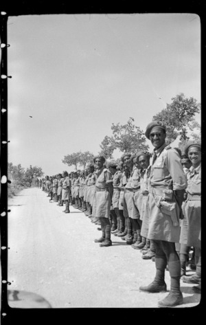 Members of 28 (Maori) Battalion lining the roadside for the visit of Winston Churchill, Italy - Photograph taken by W Brodie
