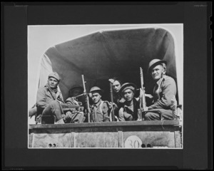 Members of the 28th New Zealand (Maori) Battalion on the last stage of a journey between Alamein to Tripoli - Photograph taken by Harold Gear Paton