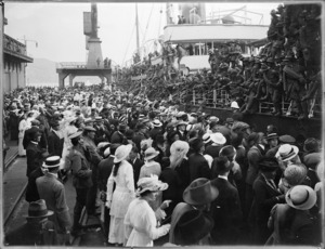 Crowd watching troops embarking for duty, World War One