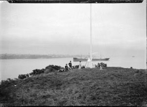 People gathered round the flagstaff at Northcote, Auckland