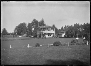 View of the bowling green and club house at Cambridge, circa 1920.