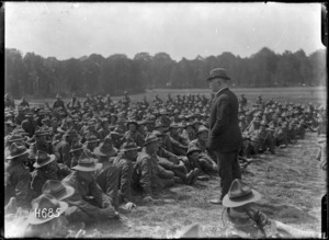 Prime Minister William Massey addressing New Zealand machine gunners at Bois-De-Warnimont, France, during World War 1