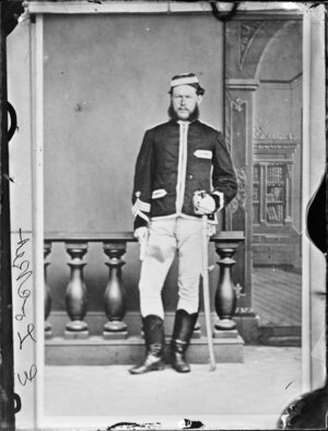 Mr E Locket, in uniform and with sabre