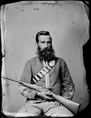 Mr Thurston, in uniform with rifle