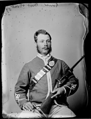 Mr Alfred Gower, in uniform and with rifle