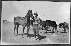"Unidentified soldier and a horse named ""Bones."""