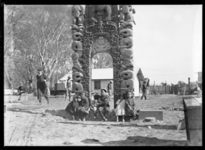 Children beneath waharoa (carved gateway) of inner pa at Christchurch Exhibition