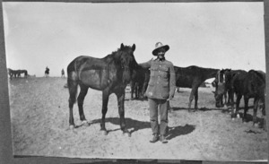 "Unidentified soldier and a horse named ""Dick."""