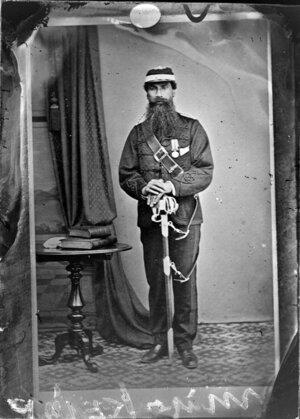Major Kemp (Te Kepa Te Rangihiwinui) in military uniform with sabre