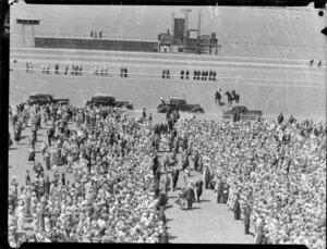 Queen Elizabeth II and the Duke of Edinburgh walking through the crowd at Trentham Racecourse, Royal Tour 1953-1954