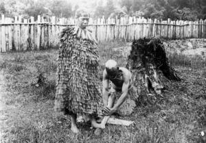 Maori man and woman lighting a fire