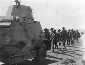 Probably shows South African soldiers being marched back after the taking of Tobruk during World War II