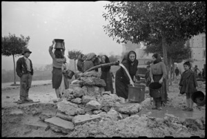 Women collecting water in the war damaged village of Gessopalena, Italy