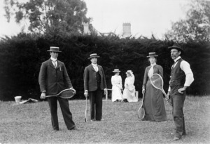 Members of the Reynolds family ready for tennis on the lawn at Fairburn