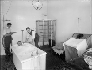 Man undergoing therapeutic treatment in a bath