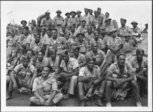 Soldiers of the Maori Battalion waiting on a quay at Alexandria, Egypt, to board transport for Italy