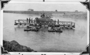 New Zealand soldiers transporting a tank over the Po River, Italy, during World War 2