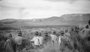 Soldiers watching shell burst, Waiouru Army Training Camp