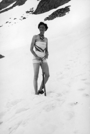 Photograph of a woman standing in the snow