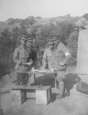 Four soldiers standing eating at a table, Gallipoli, Turkey