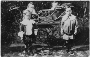 Young children with a pram