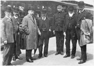 Unidentified group of men on a railway platform, Wellington-Manawatu line