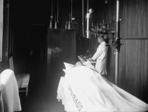 A man receiving theraputic treatment at the Government Sanatorium and Baths, Rotorua