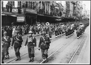 United States troops and brass band, marching down Queen Street, Auckland