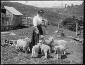 Woman feeding lambs