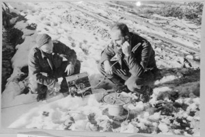 Two New Zealand Soldiers testing ground lines, Italy