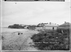 Girl with dogs on Sulphur Beach, Northcote, Auckland