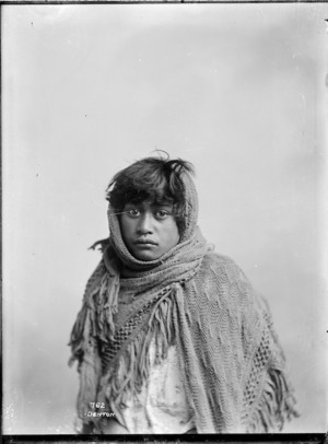 Young Maori girl wrapped in a shawl - Photograph taken by Frank J Denton