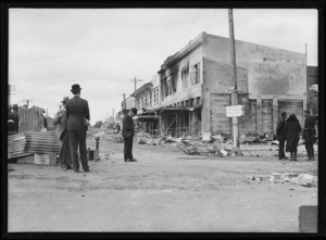 Governor-General Lord Bledisloe photographing earthquake damage in Heretaunga Street, Hastings