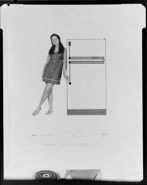 Girl standing by fridge
